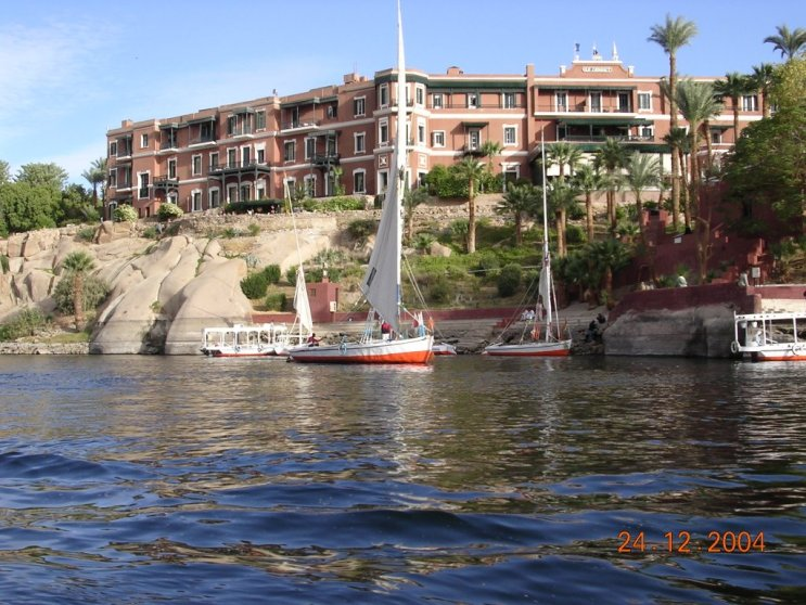 "Behind the felluca is Aswan's Old Cataract Hotel, now a Sofitel property,  where Agatha Christie wrote, ""Death on the Nile."""